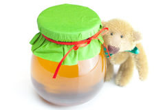 Teddy bear and  jar of honey Stock Photo
