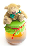 Teddy bear  and  jar of honey Stock Photos