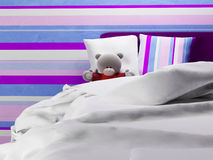 Teddy bear jn the bed Stock Images