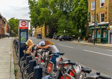Teddy bear Journey - London - UK. London - UK - 8/8/18 - A teddy bear sitting on a London bike - London - UK royalty free stock image