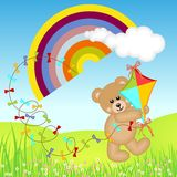 Teddy Bear with Kite Wind on Rainbow Stock Images