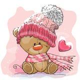 Teddy Bear in a knitted cap. Cute Cartoon Teddy bear in a knitted cap sits on a snow Royalty Free Stock Image