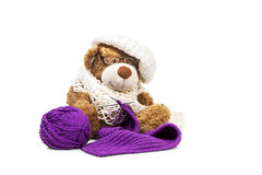 Teddy bear knitting a scarf Royalty Free Stock Photography