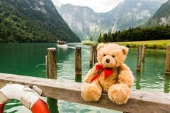 Teddy bear on Konigsee lake in Germany. Teddy bear Dranik on Konigsee lake in Germany stock photo