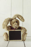 Teddy Bear Like Home Made Bunny Rabbit on Wooden White Backgroun Stock Image