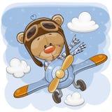 Teddy Bear lindo está volando en un avión stock de ilustración