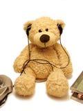 Teddy-bear listening music stock image