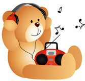 Teddy bear listening to music with headphones and  Stock Photo