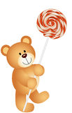 Teddy bear with lollipop Royalty Free Stock Image