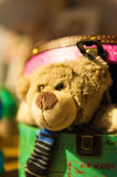 Teddy bear looks out from colorful boxes Royalty Free Stock Image