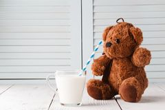 Teddy bear love milk, kid breakfast concept royalty free stock photography