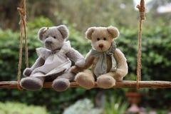 Teddy bear in love. Two teddy bear in love on a swing Stock Photos