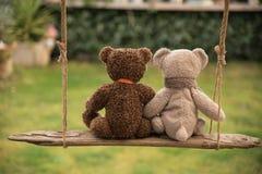 Teddy bear in love. Two teddy bear in love on a swing Stock Photo