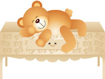 Teddy bear lying down chest of drawers Stock Images