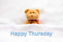 Free Teddy Bear Lying In The White Bed With Message Happy Thursday Stock Photos - 77278733