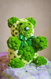Teddy bear made by green flowers Stock Photos