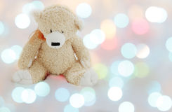 Teddy bear in magic xmas light Stock Image