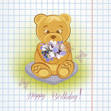 Teddy bear on the meadow with flowers. Royalty Free Stock Images