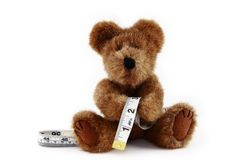 Teddy Bear With Measuring Tape Royalty Free Stock Photography