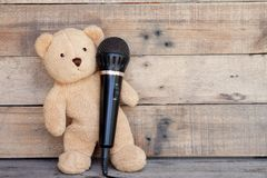 Teddy Bear and Microphone. royalty free stock photos