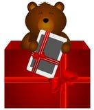 Teddy Bear mit Tablette in der Geschenkbox Lizenzfreies Stockbild