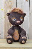 Teddy-bear Mocca against wooden boards Royalty Free Stock Images