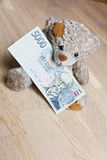 Teddy bear and money Royalty Free Stock Image