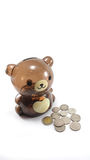 Teddy bear money box Stock Photo