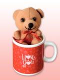 Teddy bear in a mug. Teddy bear in a lovely mug stock photo