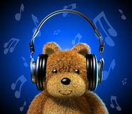Teddy bear with music headphones. Blue background with musical notes. Royalty Free Stock Images