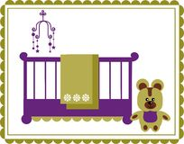 Teddy bear next to baby cradle and mobile Stock Photos