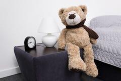 Teddy bear on nightstand Stock Photography