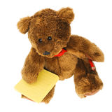 Teddy bear with notes and pencil. Teddy bear writer sitting and dreaming with yellow lined post-it notes and read pencil on white background stock photography