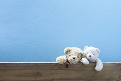Teddy bear on old wood ,blue wall background. Teddy bear on old wood ,blue wall background Stock Photo