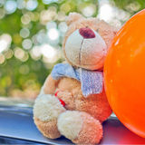 Teddy bear and orange balloon Stock Image