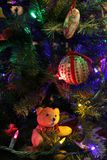 Teddy Bear Ornament on Christmas Tree. Close Up of Holiday Decorations stock image