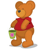 Teddy bear with pail in red T-short Stock Photo