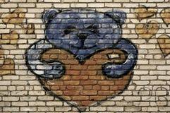 Teddy bear painted on brick wall. Street art royalty free stock photo