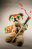 Teddy bear painted in red, orange and green Royalty Free Stock Image