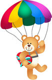 Teddy bear parachute holding heart Royalty Free Stock Photography