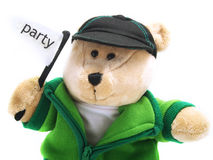 Teddy bear with party flag Stock Image