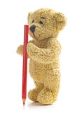 Teddy bear with pencil Royalty Free Stock Photography