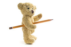 Teddy bear with pencil Stock Images