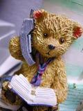 Teddy bear on phone stock photos