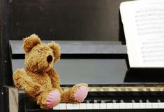 Teddy bear after the piano Royalty Free Stock Image