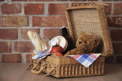 Teddy bear in picnic basket stock images