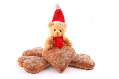 Teddy bear on pile of honey-ca Stock Images