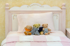 Teddy bear on a pink bed Royalty Free Stock Photo