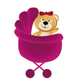 Teddy bear in a pink carriage Royalty Free Stock Photo