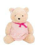 Teddy Bear In Pink Dress poner crema Fotografía de archivo